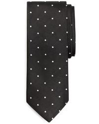 Cravate á pois noire et blanche