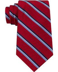 Cravate à rayures verticales blanc et rouge et bleu marine