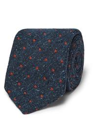 Cravate en soie á pois bleu marine