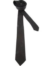 Cravate en soie á pois noire et blanche