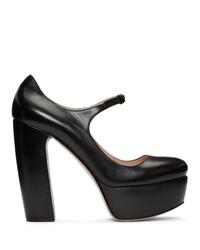 Escarpins en cuir épaisses noirs Miu Miu