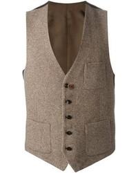 L'association d'un blazer gris foncé et d'un gilet peut te démarquer de la foule.