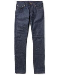 Pense à associer un blazer gris foncé avec un jean pour achever un look habillé mais pas trop.