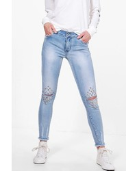 Jean skinny à clous bleu clair