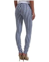 Jean skinny à rayures verticales blanc et bleu marine