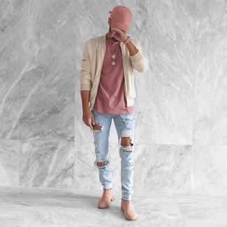 Choisis pour le confort dans un blouson aviateur beige et un jean skinny déchiré bleu clair. Une paire de des bottines chelsea en daim roses ajoutera de l'élégance à un look simple.
