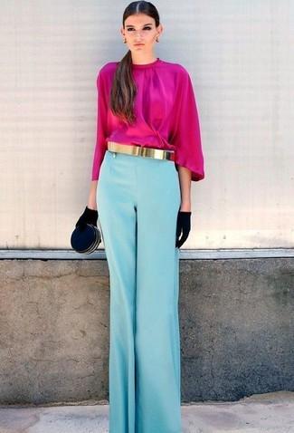 Comment porter une ceinture dorée: Essaie de marier un chemisier à manches longues fuchsia avec une ceinture dorée pour une tenue relax mais stylée.