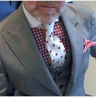 Comment porter une pochette de costume rouge: Pense à opter pour un complet à carreaux gris et une pochette de costume rouge pour un look de tous les jours facile à porter.