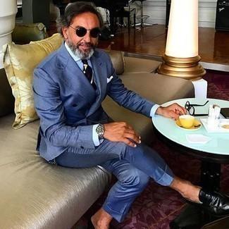 Comment porter des slippers en cuir noirs: Pense à porter un costume bleu et une chemise de ville bleu clair pour une silhouette classique et raffinée. Si tu veux éviter un look trop formel, choisis une paire de des slippers en cuir noirs.