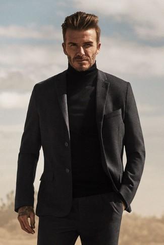 a5a75f44ff68 Tenue de David Beckham  Costume en laine gris foncé