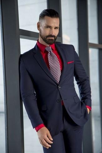 Comment porter une pochette de costume rouge: Porte un costume noir et une pochette de costume rouge pour affronter sans effort les défis que la journée te réserve.