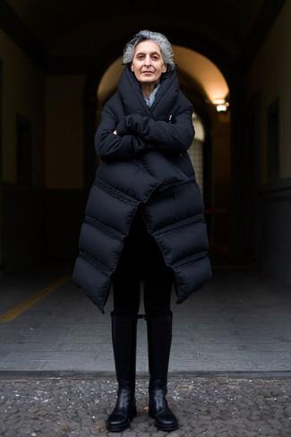 Comment porter: doudoune longue noire, leggings noirs, bottes hauteur genou en cuir noires