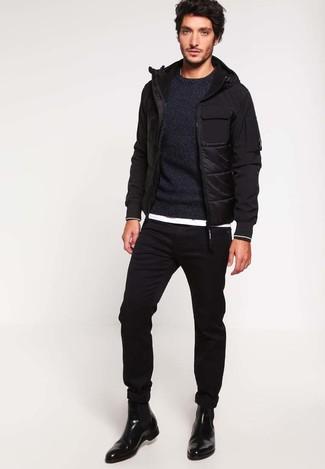 Comment porter: doudoune noire, pull à col rond noir, t-shirt à col rond blanc, jean skinny noir