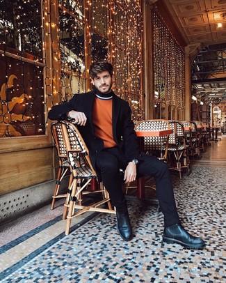 Comment porter: pardessus noir, pull à col roulé orange, jean noir, bottines chelsea en cuir noires