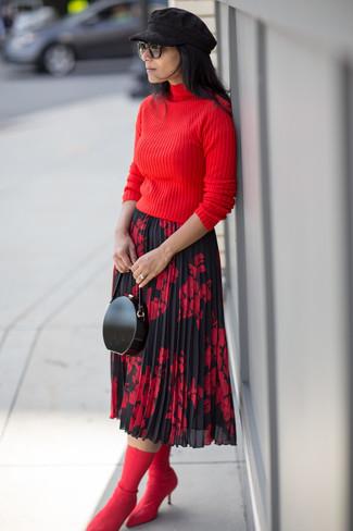 Comment porter: pull à col roulé rouge, jupe mi-longue à fleurs rouge et noir, bottines élastiques rouges, pochette en cuir noire