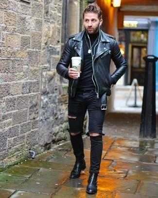 Comment porter: veste motard en cuir noire, pull à col roulé noir, jean skinny déchiré noir, bottines chelsea en cuir noires