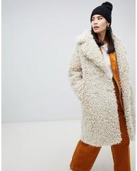 Manteau de fourrure beige Monki