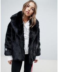 Manteau de fourrure noir Jakke