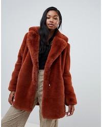 Manteau de fourrure rouge Bershka