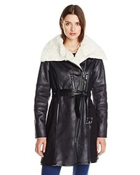 Manteau en peau de mouton retournée noir et blanc