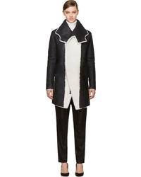 Manteau en peau de mouton retournée noir et blanc Anthony Vaccarello