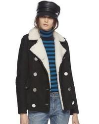 Manteau en peau de mouton retournée noir et blanc Gucci