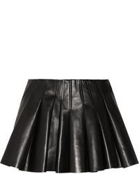 Minijupe en cuir plissée noire