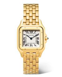 Montre dorée Cartier