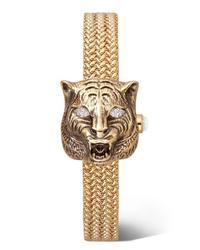 Montre dorée Gucci