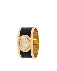 Montre noire et dorée Gucci