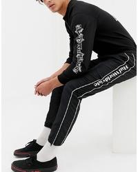 Pantalon de jogging à rayures verticales noir et blanc HUF