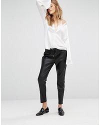 Pantalon de jogging en cuir noir Mango
