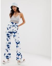 Pantalon flare imprimé tie-dye blanc ASOS DESIGN