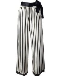 Pantalon large à rayures verticales blanc et noir Jean Paul Gaultier