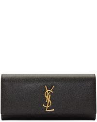 Pochette en cuir noir et doré Saint Laurent