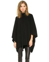 Pense à harmoniser un jean skinny noir avec un poncho pour obtenir un look relax mais stylé.