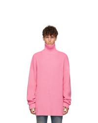 Pull à col roulé en tricot rose