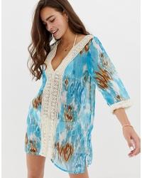 Robe de plage imprimé tie-dye turquoise En Creme