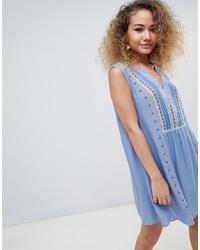 Robe style paysanne brodée bleu clair En Creme