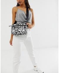 Sac bandoulière en cuir imprimé noir et blanc DKNY
