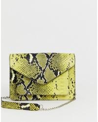 Sac bandoulière en cuir imprimé serpent jaune Pieces