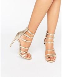 Sandales à talons en cuir dorées Aldo