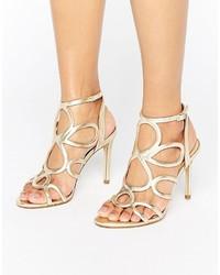 Sandales à talons en cuir dorées Carvela
