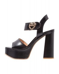 Sandales à talons en cuir noires Moschino