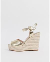 Sandales compensées en cuir dorées Aldo