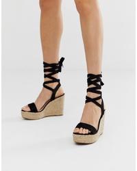 Sandales compensées en daim noires Glamorous
