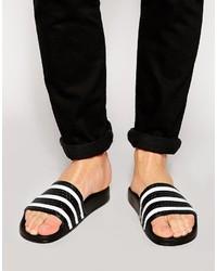 Sandales en caoutchouc à rayures horizontales blanches et noires