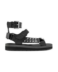 Sandales plates en cuir à clous noires Prada