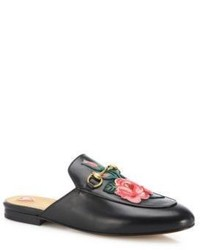 Sandales plates en cuir à fleurs noires
