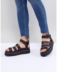 Sandales plates en cuir noires Dr. Martens